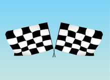 Racing Flags. Two checkered racing flags in front of a sky blue background royalty free illustration