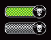 Racing flags and skull on green and black checkers Stock Photo