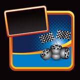 Racing flags and tires stylized banner. Orange stylized advertisement with racing checkered flags and tires Stock Photo