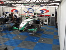 RACING GARAGE. A world series single seater on jacks in the garage at the GT Open event at Monza 2008 Stock Image