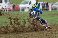 Racing grasstrack rider. ALVELEY, UK - OCTOBER 1: A solo rider competing in the autumn grasstrack meeting hosted by Bewdley MCC exits the top corner of the Royalty Free Stock Photography