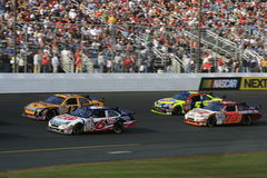 Racing Hard. David Ragan, Kyle Busch, Matt Kenseth and Joe Nemechek race for position at New Hampshire International Speedway to start the 2007 Chase for the Royalty Free Stock Photo