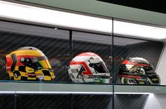 Racing helmets. Team driver racing helmets are displayed in the glass trophy case at the North American International Auto Show in Detroit Michigan USA Stock Photo