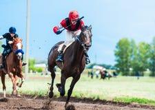 Racing on horseback Royalty Free Stock Photos