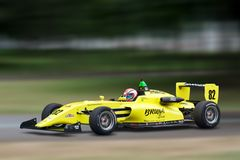 Racing indycar vehicle speeding on track royalty free stock photography