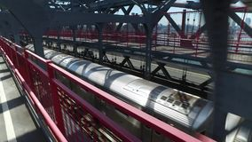 Racing a Manhattan Subway on the Williamsburg Bridge. Racing a New York City subway train on the Williamsburg Bridge over the East River between Manhattan and stock footage
