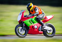 Racing motorbike. Modern racing motorbike, red and green on the track Stock Images