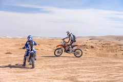 Racing motorcycles on the desert Stock Photography