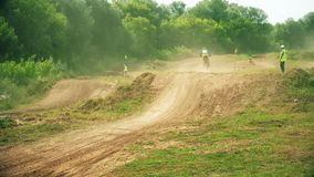 Racing on motorcycles, jumping on a dusty road stock video footage