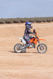 Racing motorcycles for teenagers on desert Royalty Free Stock Photography