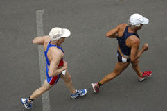 Racing pair. Two competitiors in a triathlon race, taken from above. Motion blur on their feet Stock Image