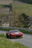 Racing rally car and village church Royalty Free Stock Image