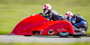 Racing sidecar motorsport. Red racing sidecar motorsport on racetrack at speed stock photography