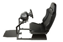 Racing simulator cockpit with seat and wheel Royalty Free Stock Photo