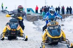 Racing of snowmobiles Stock Photos