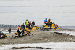 Racing of snowmobiles Stock Photos
