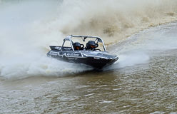 Racing speedboat competing at high speeds Royalty Free Stock Images