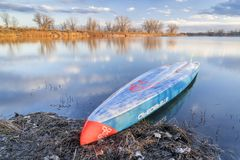 Racing stand up paddleboard on a calm lake Stock Image