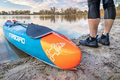 Racing stand up paddleboard on a calm lake royalty free stock photo