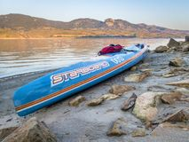 Racing stand up paddleboard on lake shore Royalty Free Stock Photography