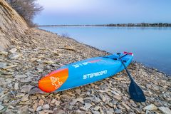 Racing stand up paddleboard by Starboard Royalty Free Stock Photo