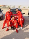 Racing team posing in front of Mini Royalty Free Stock Photos
