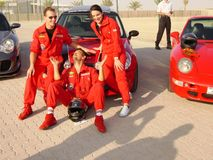 Racing team posing in front of Mini Stock Photo