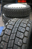 Racing tires. Rally racing snowtires equipped with nails for better grip and handling Stock Photography