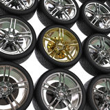Racing tires with chrome and gold rims Stock Image