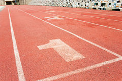 Racing track. Artificial plastic racing track with number royalty free stock image