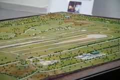 Racing Track Map Model. A miniature model of a dirt racing track stock photos