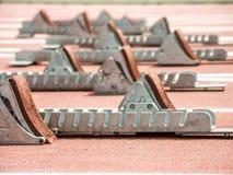 Racing track with running blocks. Closeup shot of starting blocks on racing track royalty free stock photos