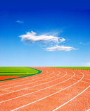 Racing track under beautiflul sky. Racing track with a blue sky and white cloud royalty free stock images