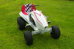 Racing Tractor Parked on Grass Stock Photo