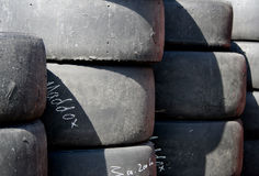 Racing Tyres. A stack of slick racing tyres Stock Image