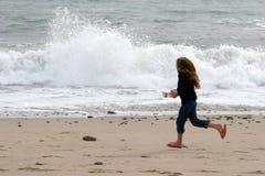 Racing the waves Stock Photos