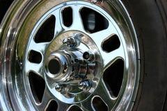 Racing Wheel. Closeup of a chrome performance racing wheel Royalty Free Stock Photo