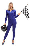 Racing woman holding a checkered race flag Royalty Free Stock Photos