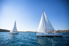 Racing yacht in the Aegean Sea on blue sky background. Luxury Lifestyle. Royalty Free Stock Photo