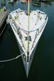 Racing yacht in the harbour. Small, white racing yacht in the harbour Royalty Free Stock Photography