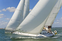 Racing Yachts. Two beautiful white yachts racing close to each other on a bright sunny day Royalty Free Stock Photo