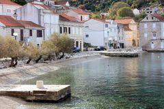 Racisce Croatia beach and dock. Račišće, island Korčula, Croatia. View of town centar with beach and small port Stock Image