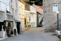 Racisce Croatia town detail. Račišće, island Korčula, Croatia. View of town centar with stone made houses and cross Stock Images