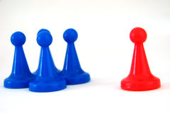 Racism. Some pieces of a game on a white background Stock Photography
