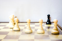 Racism. Metaphor of racism done with chess pawns royalty free stock photo