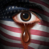 Racism In America. And bigotry in the USA concept as the tear of an American minority washing away a flag of the United States painted on a face as a civil vector illustration