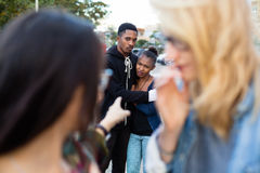 Racism - black couple being bullied. People pointing with finger on them Stock Photography