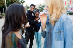 Racism - black couple being bullied. People pointing with finger on them Stock Images