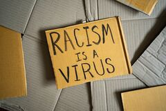 Free Racism Is A Virus Was Written On A Cardboard Royalty Free Stock Photography - 213991917