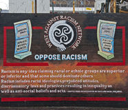 Racism Mural on the Falls Road. A mural opposing racism. It is located on the Falls Road, one of the most infamous roads in Belfast, Northern Ireland. The Falls Royalty Free Stock Image